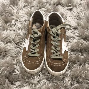 Brown sneakers with gold star